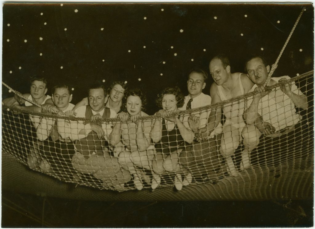 circus perfomers in a safety net